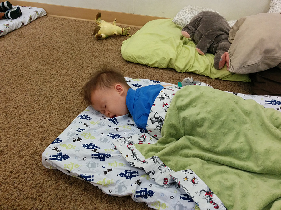 baby boy napping at daycare
